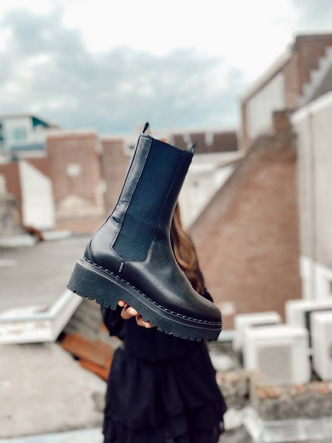 Hoe stijl je hoge chelsea boots?